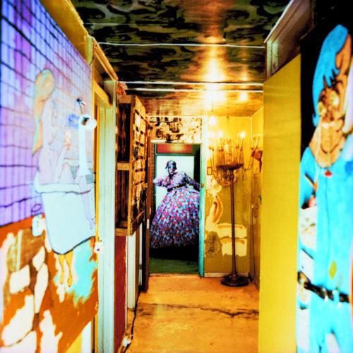 Mavericks: Looking down the hallway of Leigh Bowery's extraordinary flat.