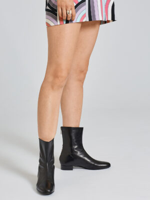 Ops&Ops No12 Classic Black boots worn with multi-coloured print short dress