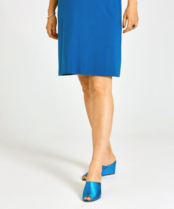 Ops&Ops No15 Turquoise wedges worn with above-the-knee blue dress