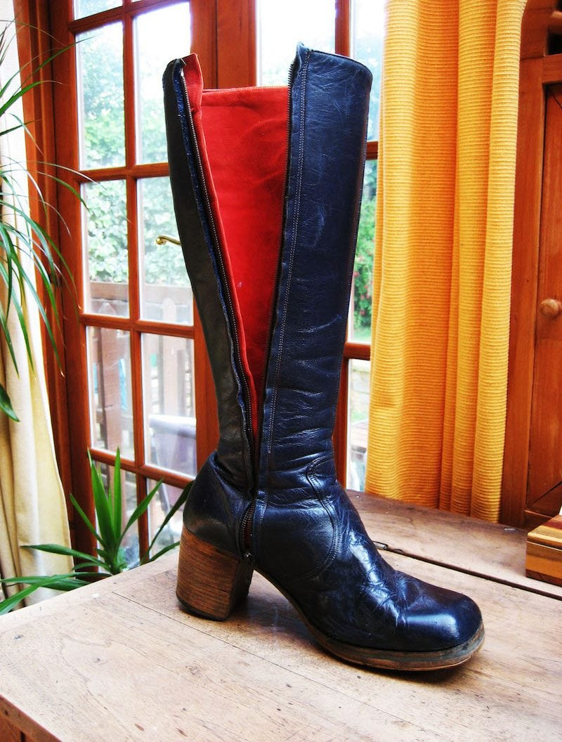 Mair's boots showing side zip undone to reveal red lining