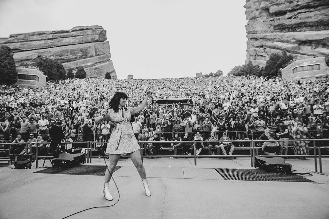 Nicole Atkins in Silver Duo on stage at Red Rocks