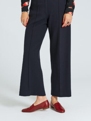 Ops&Ops No10 Claret leather flats worn with cropped, wide-leg navy trousers and patterned top