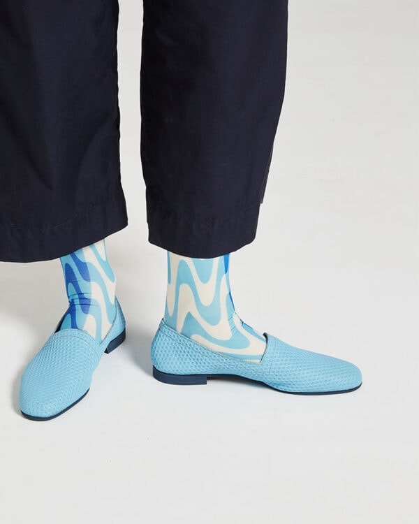 Ops&Ops No10 Action Light Blue leather flats close-up worn here with blue paisley socks and navy cropped trousers
