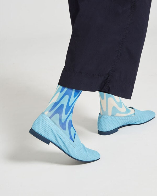 Ops&Ops No10 Action Light Blue leather flats back close-up worn here with blue paisley socks and navy cropped trousers