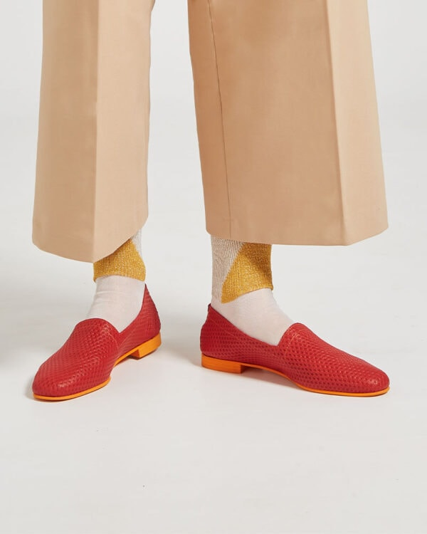 Ops&Ops No10 Action Red leather flats close-up worn with gold socks, and cropped tan trousers