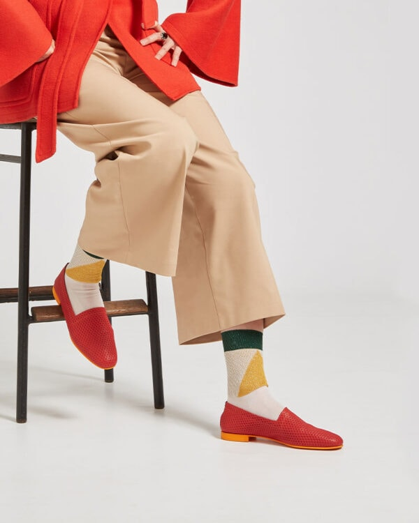 Ops&Ops No10 Action Red leather flats worn with colour-block socks, tan cropped trousers and tie-belt vibrant jacket