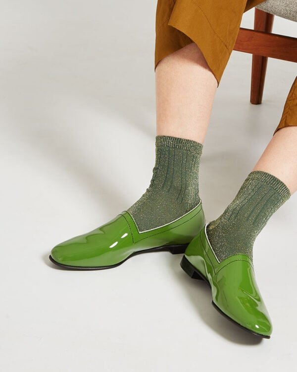 Ops&Ops No10 Avocado patent leather flats close-up seen here with green lurex socks and cropped khaki trousers