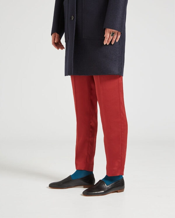 Ops&Ops No10 Classic Black leather flats worn with navy wool coat, rust-coloured slim-leg trousers and teal socks