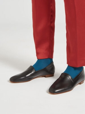 Ops&Ops No10 Classic Black leather flats close-up worn with rust-coloured slim-leg trousers and teal socks