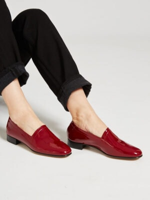 Ops&Ops No11 Crimson patent leather block heels worn with rolled-up black jeans
