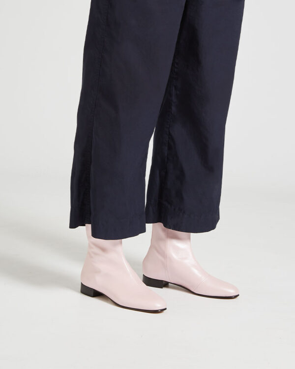 Ops&Ops No12 Pink Frost leather go-go boots, worn with cropped navy blue trousers