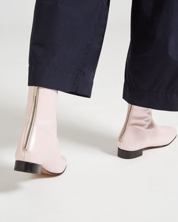 Ops&Ops No12 Pink Frost leather go-go boots, worn with cropped navy trousers close-up of zips