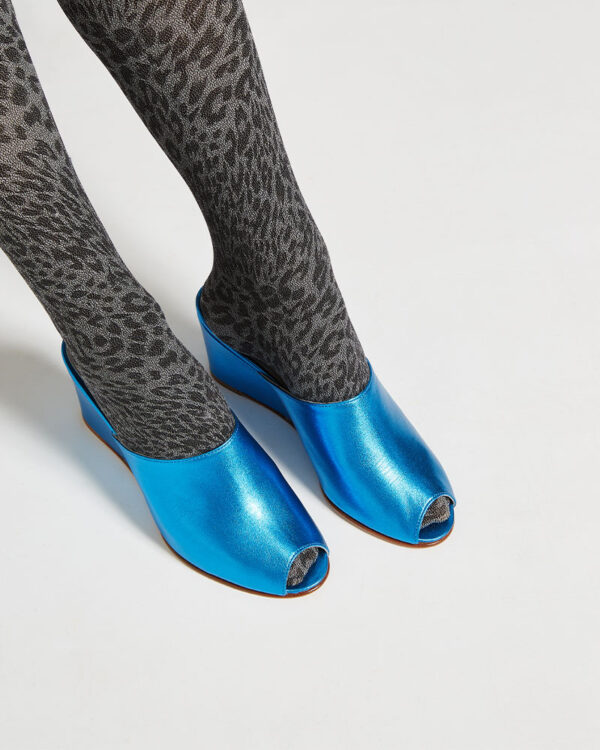 Ops&Ops No15 Turquoise leather wedge mules close-up worn with grey animal print tights