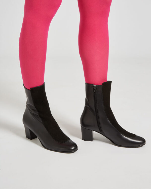 Ops&Ops No16 Black Duo mid-heel leather boots close-up worn with red tights Avocado Ops&Ops No16 Black Duo mid-heel leather boots close-up worn with cropped wide-leg tan trousersmid-heel leather boots close-up worn with cropped wide-leg tan trousers