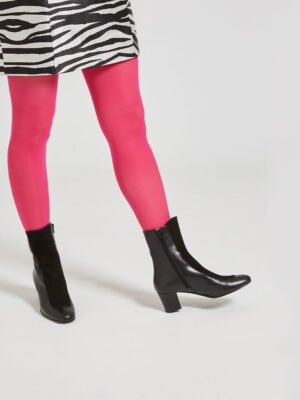 Ops&Ops No16 Black Duo mid-heel leather boots worn with red tights and zebra-print short dress