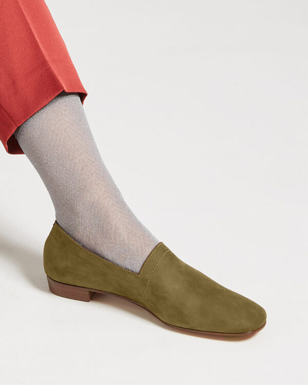 Ops&Ops No17 Olive nubuck flats close-up worn with grey fine socks and rust slim-leg trousers