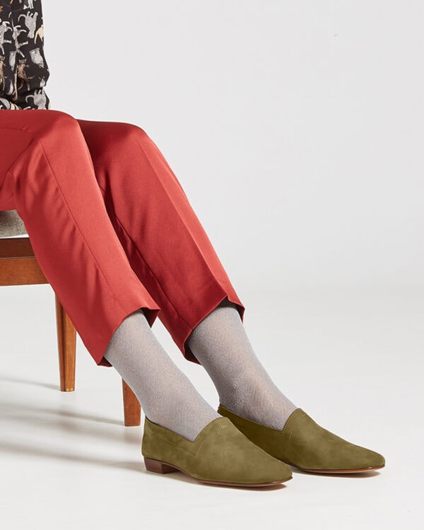Ops&Ops No17 Olive nubuck flats worn with grey fine socks and rust slim-leg trousers