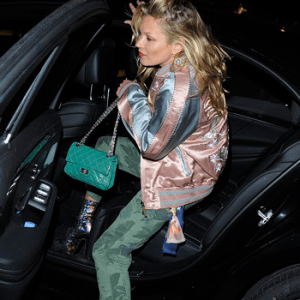 Camouflage: Kate Moss in camo jumpsuit and satin bomber