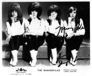 The Shangri-Las pose in white go-go boots